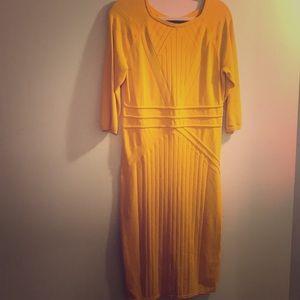 Gabrielle Union mustard color dress